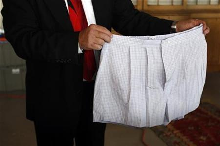 A pair of boxer shorts belonging to Bernard Madoff are displayed by an auctioneer during a media preview of the U.S. Marshals Service 'Madoff II Auction' in the Brooklyn borough of New York November 10, 2010.  REUTERS/Jessica Rinaldi
