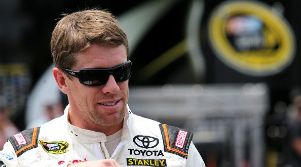 TALLADEGA, AL - APRIL 29:  Carl Edwards, driver of the #19 ARRIS Toyota, stands in the garage area during practice for the NASCAR Sprint Cup Series GEICO 500 at Talladega Superspeedway on April 29, 2016 in Talladega, Alabama.  (Photo by Jerry Markland/Getty Images)