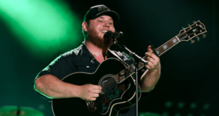 Luke Combs playing guitar