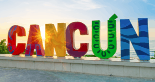 cancun sign on beach