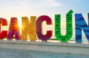 cancun sign on beach