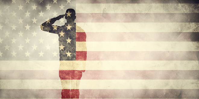 Double exposure of saluting soldier on USA grunge flag