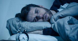 man awake at night not able to sleep