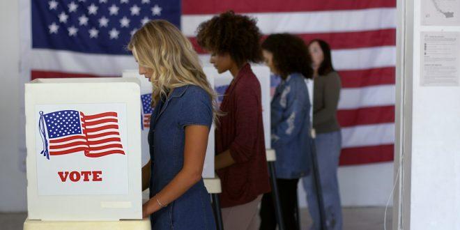 Four women of various demographics voting