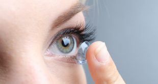 young woman with contact lens
