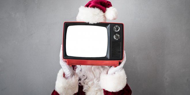 Santa Claus holding retro TV