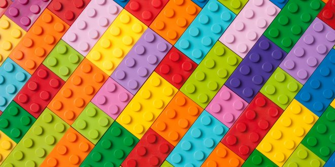 Many toy blocks in different colors making up one large square shape